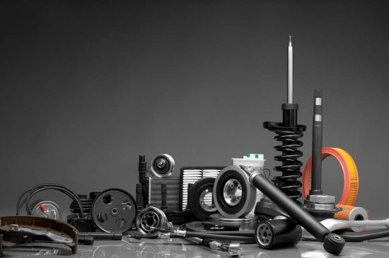 Auto parts in a pile with gray background