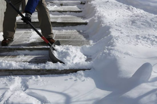 Winter blizzard: Cleaning the stairway